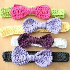 Bow Bow Bow knitted bows - to pretty and makes interesting wrapping accessories. www.rockpaperstickers.co.uk