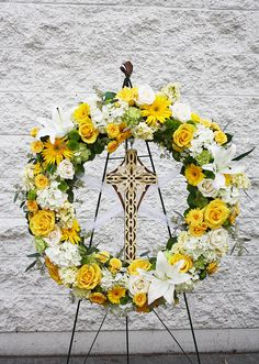 A beautiful wreath of yellows and whites - Four Seasons Flowers