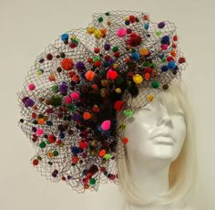 Check out this item in my Etsy shop https://www.etsy.com/listing/229376803/rainbow-pom-pom-veil-fascinator