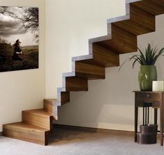 Unique Wooden Stairs Ideas With Narrow Step Plus Painting On Wall And Chest Of Drawer Understairs most unique stairs design ideas pictures with modern and minimalist style Wooden Staircase Design, Home Stairs Design, Floating Staircase, Wooden Staircases, Stairways, House Design, Stair Design, Staircase Ideas, Wall Design