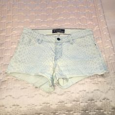 Guess cheetah print shorts Sexy Jean cutoffs. Lightly used bought it in January for a vacation and doesn't fit me anymore. The jeans are a light wash and are cheetah printed Guess Shorts Jean Shorts