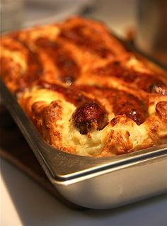 Toad in the Hole, simple British dish with onion gravy, recipe here (sausages in a yorkshire pudding batter)