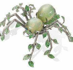 Lydia Courteille's Homage to Surrealism ..the Spider Brooch made in gold with moonstone and green garnets