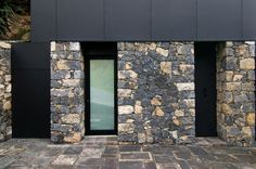 http://www.ciiwa.com/images/Gazed-Door-In-Black-Frame-Placed-Between-Stone-Wall-Finishing.jpg