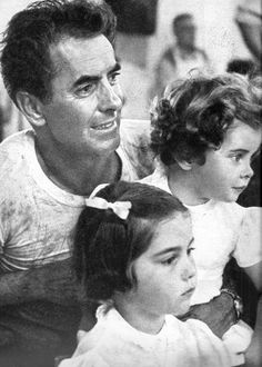 "likeadoll: "" Tyrone Power and his children in Spain during the filming of Solomon and Sheba before his death at age 44, in 1958. Photographed by Leo Fuchs. """