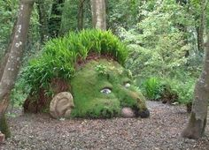 rock stump tree moss garden art model green grass.  Imagine finding this in the middle of a bush on a walk!
