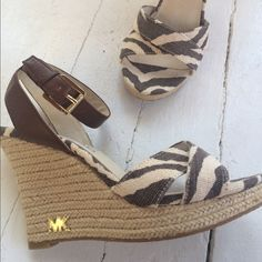 Michael Michael Kors wedges Michael by Michael Kors espadrille wedges. NWOT. Chocolate brown and cream zebra print  with brown ankle straps. Neutral but sassy. Gorgeous sandal! MICHAEL Michael Kors Shoes Wedges