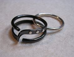 This one turned out better looking than I imagined.  I made this custom order as a variation of another ring I have listed here.  It started as one of my Two Turn Wave Energy Rings listed in this shop. I used my blackened niobium and then I added three sterling silver rivets on one side to creat...
