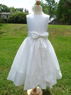 Like the skirt and the bow at waist.  Silk, Ivory First communion Dress