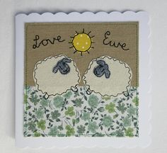 An original textile art, greetings card. The sheep design on this card has been created using cotton fabric with free machine embroidery on a background of cotton/linen. It has Love Ewe written in free machine embroidery. The high quality, scallop edged card is 6 inches (15cm) square