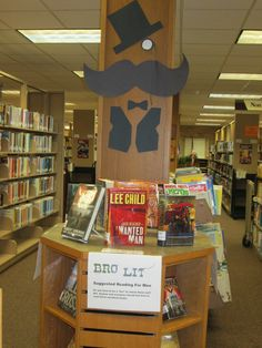 "AMPL's new ""Bro Lit"" book display.  Suggested reading for men!"