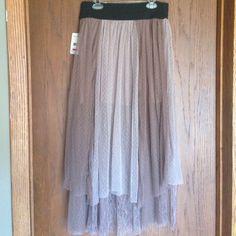 Free People Sugar Plum Tutu Skirt Tea length sheer dotted mesh tutu skirt with elastic waist. Half slip. Color is Earth Purple. Free People Skirts