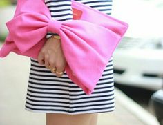 Pink with black and white stripes.