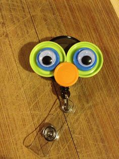 Oogle Eyes ID Badge Holder With Retractable Reel - Made From Flip Off Vial Caps (blue, orange, green, black)