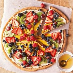 Everybody loves pizza! Try this tasty fruit pizza recipe that takes all the guilt out of pizza eating. Sugar cookie, covered with a sweet cream cheese spread, and topped with your choice of fresh fruit. Drizzle with honey for added flavor!