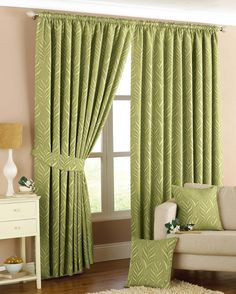 The Willow Green Pencil Pleat Curtains are a great way tomake a statement in your home. They feature a contemporary geometric leaf print and are a great way to
