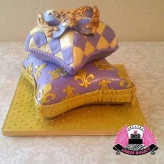 We did two cakes for two sisters' joint Quinceanera & Sweet Sixteen party, both in masquerade theme in colors to match the sisters' respective dresses. This is the Sweet Sixteen cake. My first pillow cakes. Bottom pillow is Disco. Sweet Sixteen Cakes, Sweet Sixteen Parties, Sweet Cakes, Pillow Cakes, Pillows, Dripping Springs Texas, Masquerade Theme, Cake Decorating, Prince