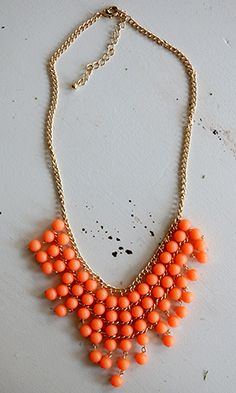 A great piece for spring in tangerine, one of the season's hottest shades; $22.