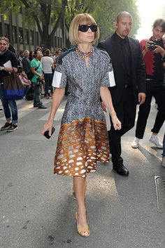 Anna Wintor wearing a printed drop-waist dress and peep-toe pumps.
