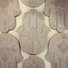 Hamsa Wall Hangings in progress. Perfect for any meditation or sacred spaces. These are still in wet clay form, but will be glazed in colors and about 9 inches tall when finished. There are brackets on the back for hanging. .