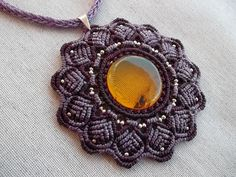 Mandala macrame necklace hand made whit resistant polyester waxed thread, silver beads and the protector power of ancient amber from Mexico  cord finish in silver 6cm diameter