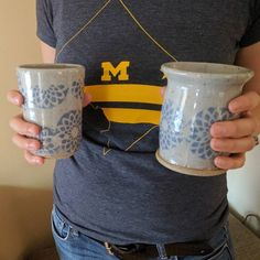 Wherever you go Go Blue (cups)! . . #goblue #wolverineforlife #tailgating #umalumni #mug #mugshot #michiganfootball #itsgreattobeamichiganwolverine #umich #handmadepottery #tumbler #tumblers #flowermug #pottery #handmadeceramics #homemadepottery #handmade #wheelthrown #ceramics #ceramic #crafts #clay #instapottery #pottersofinstagram #acreativedc #districtclay #madeindc #flowers #dcig #blueflower