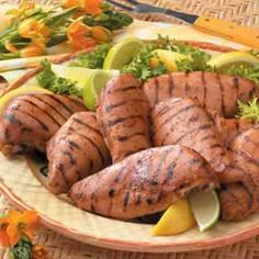 Marinated Barbecued Chicken - (One serving (1 chicken breast half) equals 205 calories, 3 g fat (1 g saturated fat), 79 mg cholesterol)