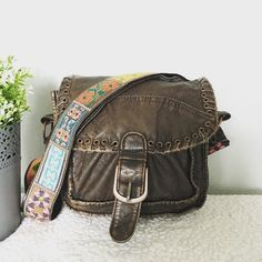 """Cross Body with Pretty Strap Cross Body Bag with patchwork Strap  ·         Brown ·         Faux leather ·         Flap closure with magnetic snap ·         Beautiful and colorful crossbody strap ·         Adjustable strap ·         Slip pocket on front ·         Interior zipper pocket ·         Measures 8.5""""x3.5""""x6.5"""" ·         Strap 23.5"""" Bags Crossbody Bags"""
