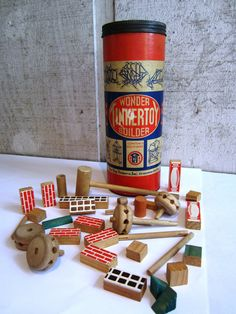 1950s Wonder Tinker Toy Builder, Canister and Toys, Vintage Toy.  Novel thought...toys that took imagination.  Loved these. I have an awesome scar from falling on one of these sticks.