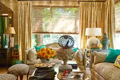 Nussabaumer covered the sofas of her Dallas sunroom in leopard print, completing the look with emerald green pillows and Moroccan pottery.