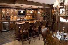 What was an old cabinet storing a TV in the dining room is now converted to a built-in bar with custom antiqued mirrors, lighting and surround sound. Description from pinterest.com. I searched for this on bing.com/images