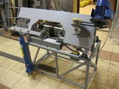 Horizontal Metal Bandsaw by radom -- Homemade horizontal metal bandsaw utilizing 250mm lathe-turned nylon wheels. Lifting mechanism is powered by an engine hoist jack. Capable of cutting 190mm round stock or 300x125mm box. http://www.homemadetools.net/homemade-horizontal-metal-bandsaw