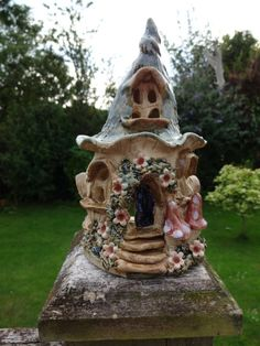 Mollie wants me to make her something like this in clay - Fairy house tea light holder ceramic candle holder