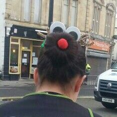 "I made my sister a ""red nosed reindeer"" head bun for a Christmas charity race. With antlers,  wobbly eyes & a red nose"