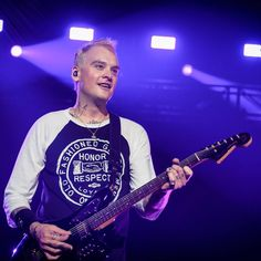 Matt Skiba looks so good with blonde hair omg