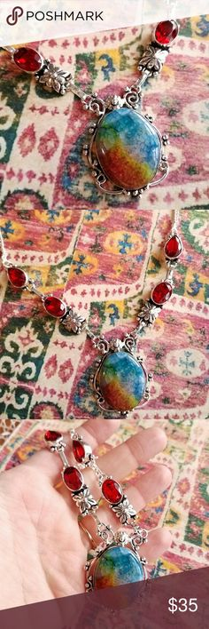 New Solar Quartz and red gems necklace boho New without tags -This beautiful necklace has dyed quartz with a veined pattern and sparkly red glass gems! It is made of silver tone metal. This is an oversized statement piece. This is stamped 925, but the necklace seems to be silver plated, so I am selling this as silver tone metal. In new condition and from a smoke free home :)    SUNA8488sno888 Jewelry Necklaces