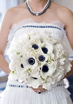 wedding bouquet made of anemones, sweet pea & lilies of the valley