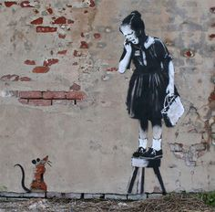 Work of Banksy- grafitti and stencil artist that knows how to use the enviroment.