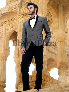 Grandiose grey color shawl lapel jute tuxedo designed with pocket flap and two buttons. Item Code: TSP2584 http://www.bharatplaza.com/new-arrivals/mens-suits.html