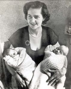 Birth: The 28-year-old Margaret Thatcher holding her twins on the day of their birth in 1953.