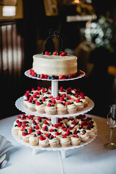 cake + cupcakes // photo by Lev Kuperman // http://ruffledblog.com/rhode-island-summer-wedding