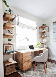 Home Office with Reclaimed wood.   Wall color: Silver Satin, Benjamin Moore; desk, shelves and chair: West Elm; window treatment: Window Treatments by Melissa, Etsy; rug: Pottery Barn; Roman shade: Etsy
