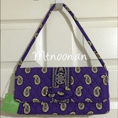 """Vera Bradley Knot Just a Clutch in SIMPLY VIOLET NEW WITH TAGS Vera Bradley """"Knot Just a Clutch"""" in SIMPLY VIOLET. Can be worn as a shoulder bag or remove the strap and carry as a clutch!  RETAIL VALUE $54.00  • Snap-in shoulder strap • Full outer zip pocket on back, plus a full zip compartment and two slip pockets inside • Magnetic flap closure • Removable strap • Dimensions: 12""""L x 5.5""""H x 2.5""""D • Strap length 24"""", strap drop 10""""   I have more VERA BRADLEY, check out my other items!   LIKE…"""