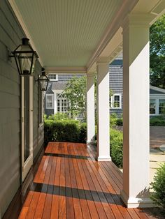 This is the color I would like to paint/stain my deck. I also Love the white columns and color of the house.
