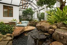 Atrium addition complete with koi pond, river, wall to wall glass and glass ceiling. How wonderful to relax in during a storm!