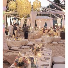 Luxurious yet relaxed beach reception where guests sit on cushions on the sand - the perfect setup for a Dubai wedding mimicking a majlis #PPEvents