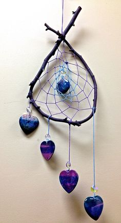 "Blue and purple weave with 5 beautiful swirled agate hearts in mystical purple and blue hues. (18""L x 6.5""W)************************************************************************Dreamcatchers are known to have mystical effects on people's dreams and sleep patterns. Dream Halos are created to enhance your dreamsand filter out negative energies. According to ancient legend,The dream catcher has been made for many generations...Hung above the beds, or ..."