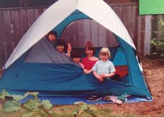 The grandchildren playing in the tent. From top left: Jasmine, Jade and Harry Seto, Bronwyn and Molly Lewis. Applecross Cr., Surrey. Summer 1992