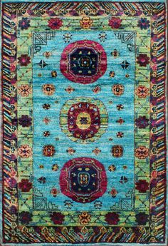 """The Rugsville multi sari silk rug collection made from recycled sari silk. The carpet is handcrafted by artisans using handspun recycled vintage Sari silk and a unique knotting technique to create the luxurious silk construction.  Fine Hand Knotted,Vintage Sari Silk, Fine Silk One of a kind unique Museum quality rug. Pattern: Abstract Fair Trade Product. Pile height is appx. ??"""" - 1"""" Primary color: Light Blue/Red"""