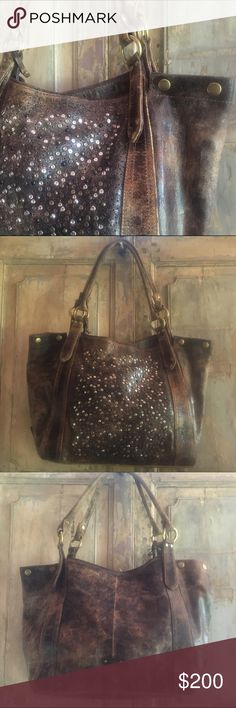 "Frye chocolate Deborah Shoulder Bag Stressed and distressed, this vintage leather shoulder bag is scattered with hand-applied studs in multiple finishes, showing off dazzling highs and lows. With its well-loved and well-worn attitude, it looks as though it has been on countless adventures, witnessed drag out bar fights and traveled the world.   - Canvas lining - 12"" height - 19"" width - One zip pocket, two slip pockets and key clip Frye Bags Shoulder Bags"